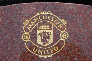 Engraved and painted Man Utd emblem