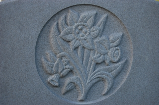 Hand carved daffodils on Yorkstone